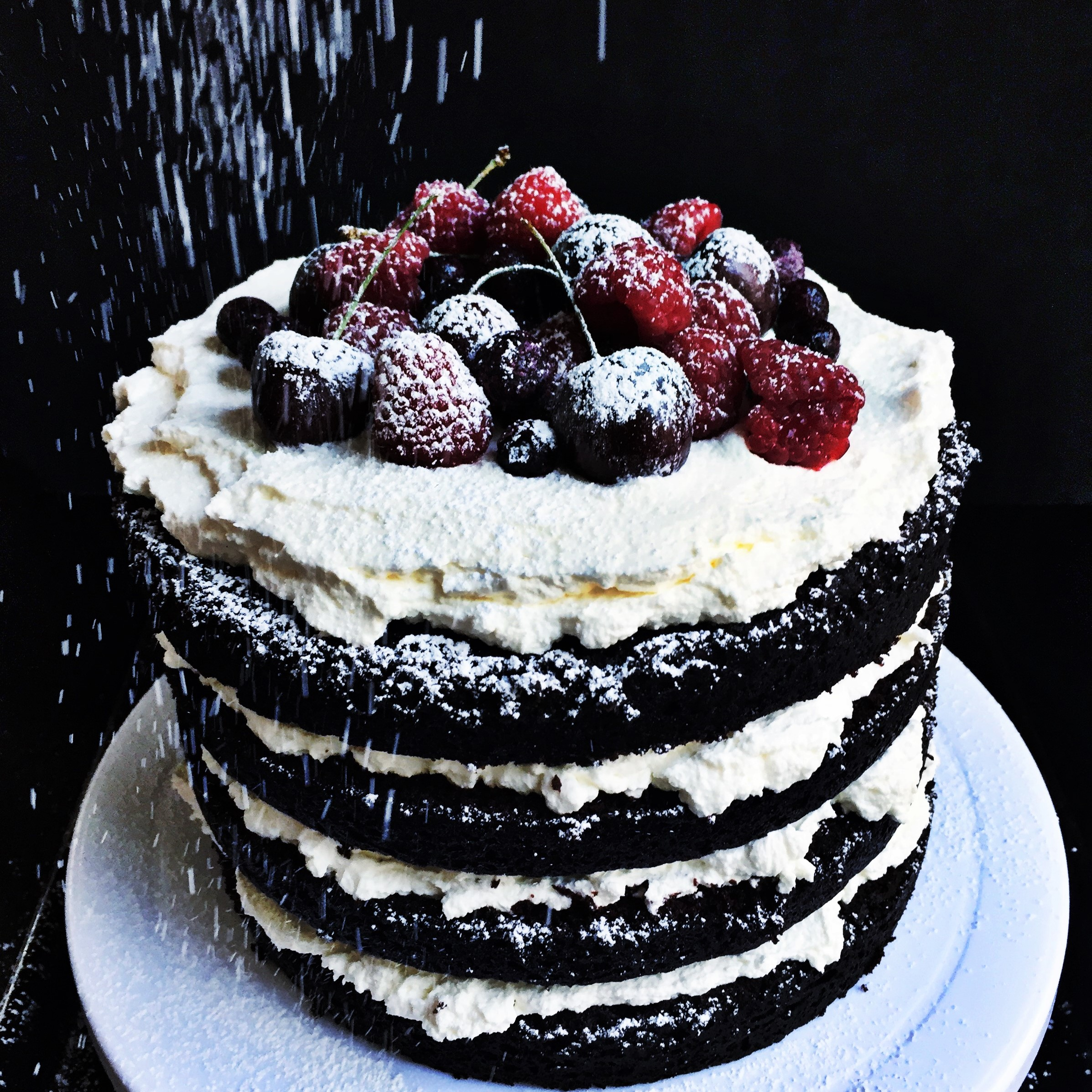 Vegan Chocolate Cake with Whipped Cream and Berries