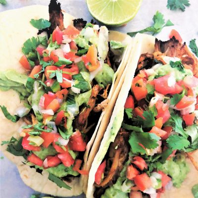 Slow Cooker Pork Carnitas Tacos with Avocado Crema